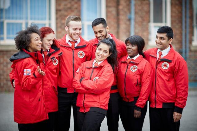 Group of volunteer mentors in red jackets