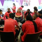 Group of volunteer mentors sitting in a circle