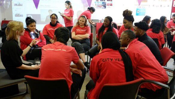 Group of volunteer mentors sitting in a circle