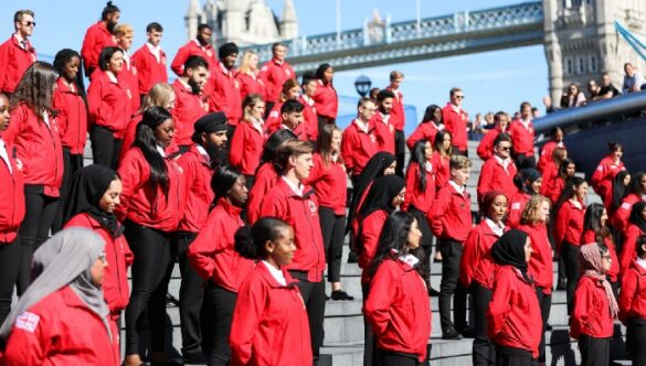 Volunteer mentors at Opening Day with the Tower Bridge in the background