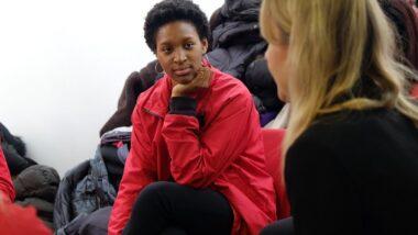 Two volunteer mentors talking