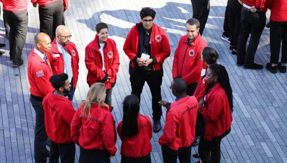 group of volunteer mentors standing in a circle