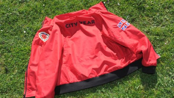 CYUK red jacket on the grass