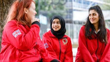 Three volunteer mentors looking at each other