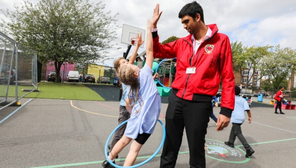 volunteer with pupils on school playground