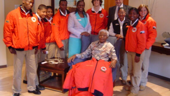 City Year South Africa service leaders standing around Nelson Mandela