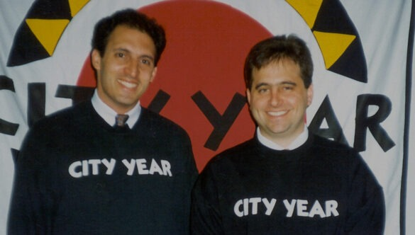 City Year's Co-Founders, Alan Khazei and Michael Brown in black City Year sweatshirts