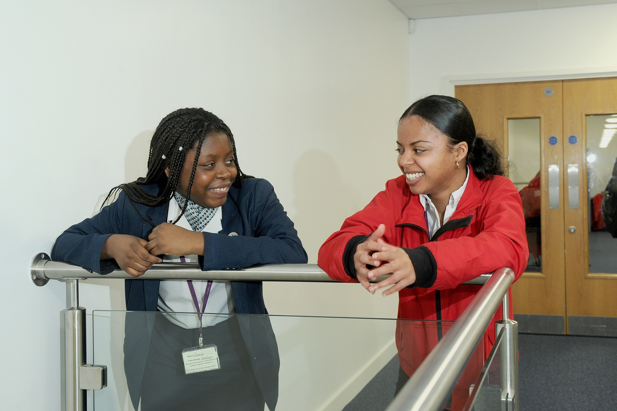 Volunteer mentor smiling with a pupil