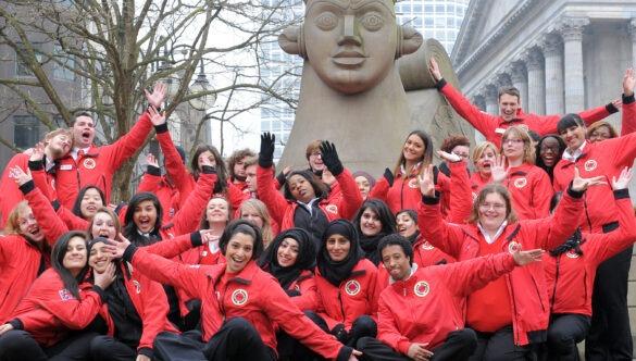 Birmingham volunteer mentors in front of a statue